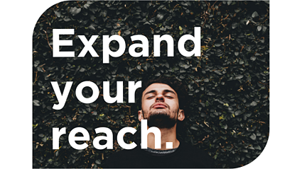 """Expand your reach."" and man standing by bush with eyes closed"
