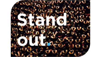"""Stand Out."" and a crowd of university graduates"