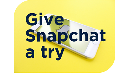 """""""Give Snapchat a try"""" and yellow background of Snapchat on a smart phone"""