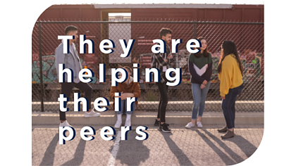 """They are helping their peers"" quote with group of teen friends hanging out by a chain link fence"